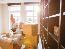 woman moving house with boxes