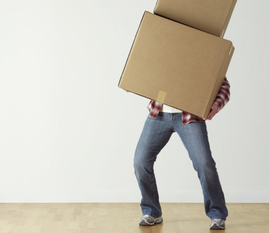 person overload with boxes